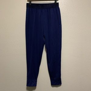 Men's navy blue Puma jogger pants with pockets
